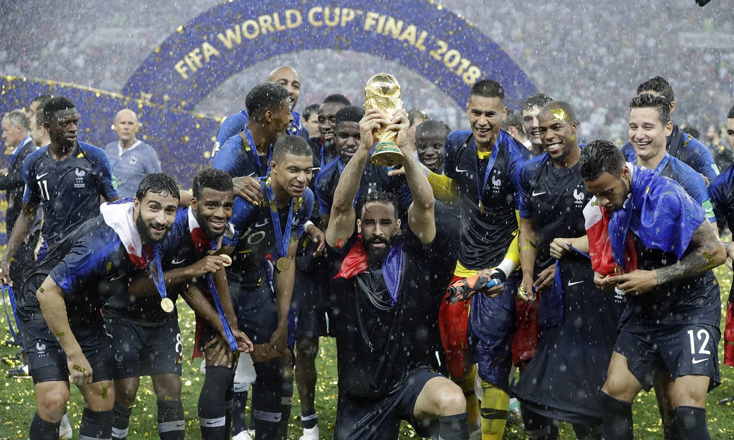 France's Adil Rami celebrates with the trophy after the final match between France and Croatia. — AP