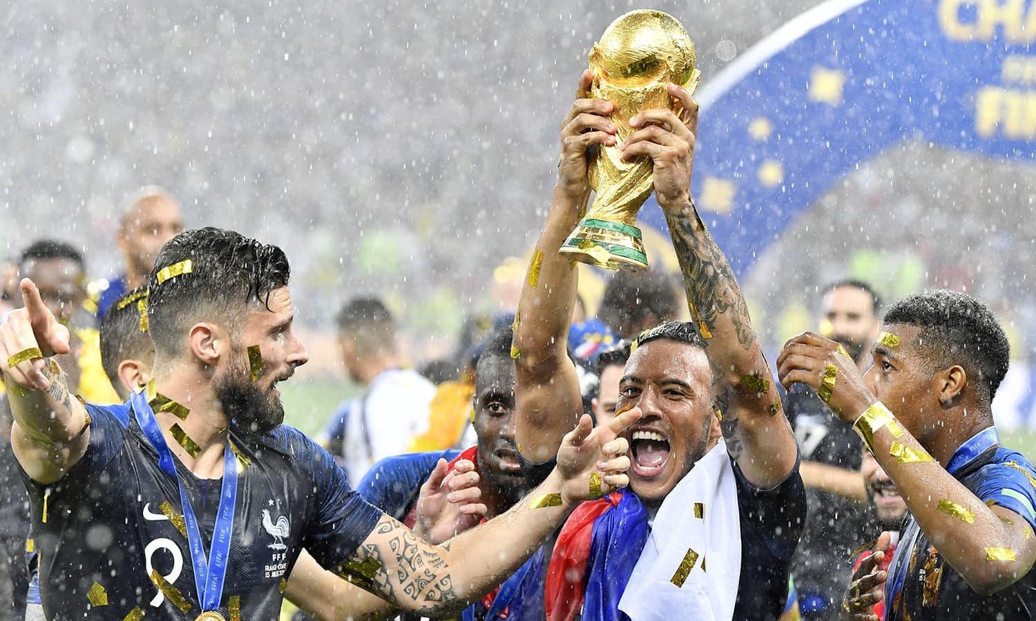 France's Olivier Giroud, left, and France's Corentin Tolisso, centre, celebrate after winning 4-2 in the final match between France and Croatia. — AP