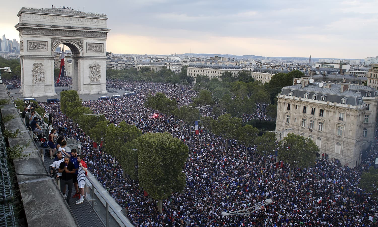 In this picture taken from the terrace of the Publicis Group, people take to the streets around the Arc de Triomphe to celebrate France's World Cup victory over Croatia, in Paris. — AP
