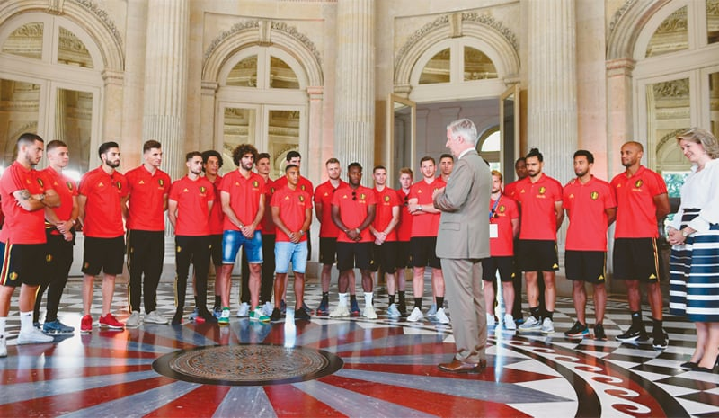 BRUSSELS: Belgium King Philippe-Filip, accompanied by Queen Mathilde, greets members of the national football team at the Royal Castle in Laeken on Sunday.—AFP