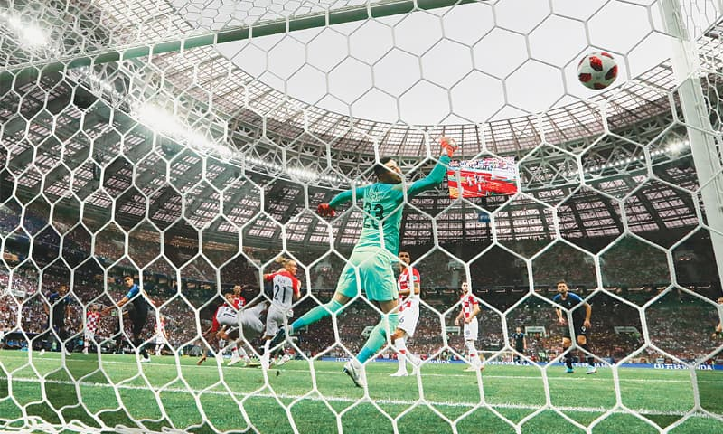MOSCOW: Croatia goalkeeper Danijel Subasic fails to block a header by team-mate Mario Mandzukic for an own goal during the final against France at the Luzhniki Stadium on Sunday.—AP
