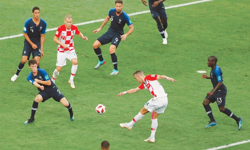 CROATIA'S Ivan Perisic (second R) shoots to score the equaliser.—AP