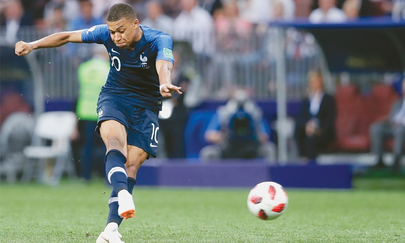 KYLIAN Mbappe shoots to score France's fourth goal.—AP