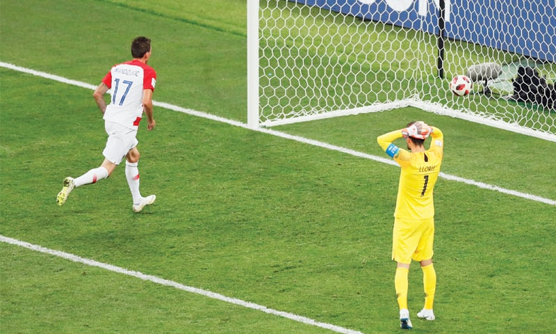 FRENCH captain Hugo Lloris (R) reacts after Mandzukic scores Croatia's second goal following a mistake by the former.—AP