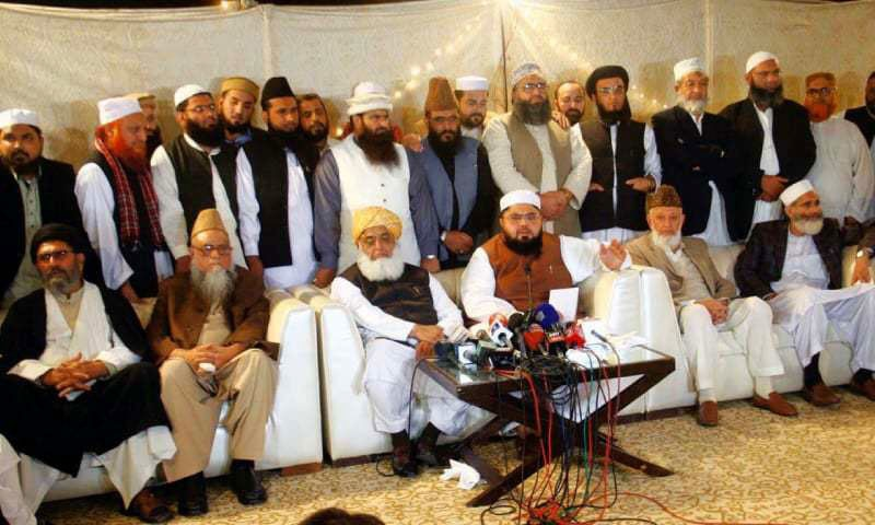 Jamiat Ulema-i-Pakistan chief Shah Ovais Noorani addressing a press conference at Bait-ul-Rizwan in Clifton after the decision to revive the Muttahida Majlis-i-Amal. Other leaders of the five-party alliance are also seen.—Online
