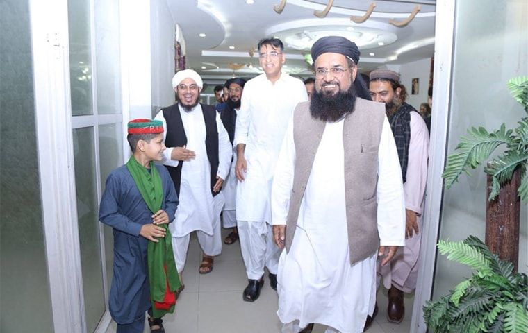 This picture, shared by the official Facebook page of Pakistan Tehreek-i-Insaf candidate Asad Umar, shows Maulana Fazlur Rehman Khalil leaving the marquee where a meeting between the two leaders was held on Tuesday.