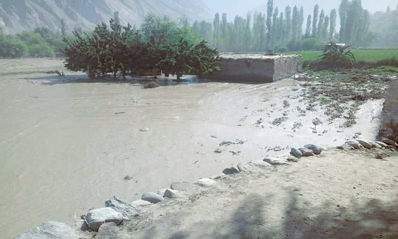 REMINISCENT of the lake formed near Attabad village because of a landslide that blocked the Hunza River in 2010, a small glacier melt on Wednesday swelled Barsuwat Nullah in Ghizer district, causing an artificial lake and submerging several houses in the area.—Photo by writer