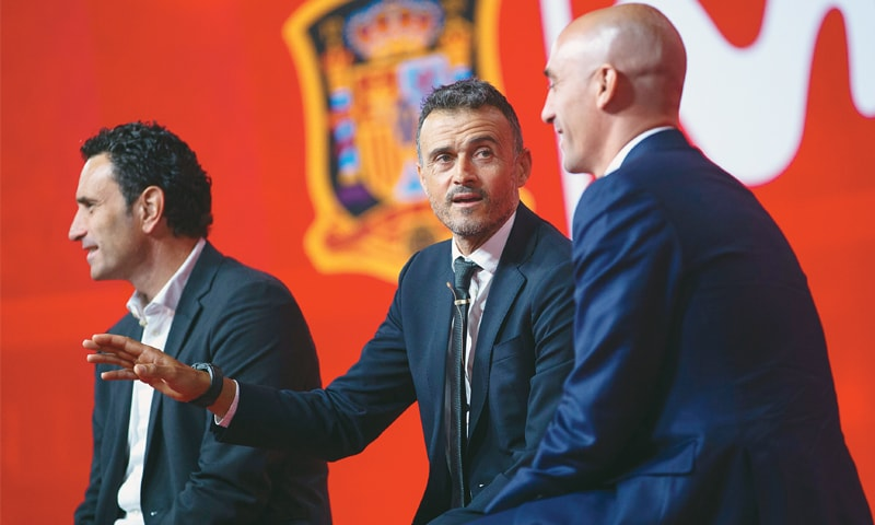 MADRID: Newly-appointed Spain coach Luis Enrique (C) talks to reporters next to Spanish football president Luis Rubiales (R) and sports director Jose Francisco Molina.—AP