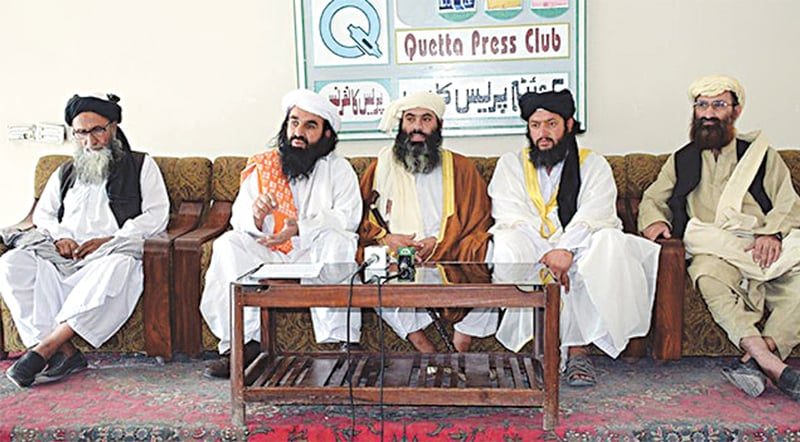 ASWJ provincial chief Ramzan Mengal (centre) addresses a press conference with JUI-Nazriyati leaders in June at the Quetta Press Club.
