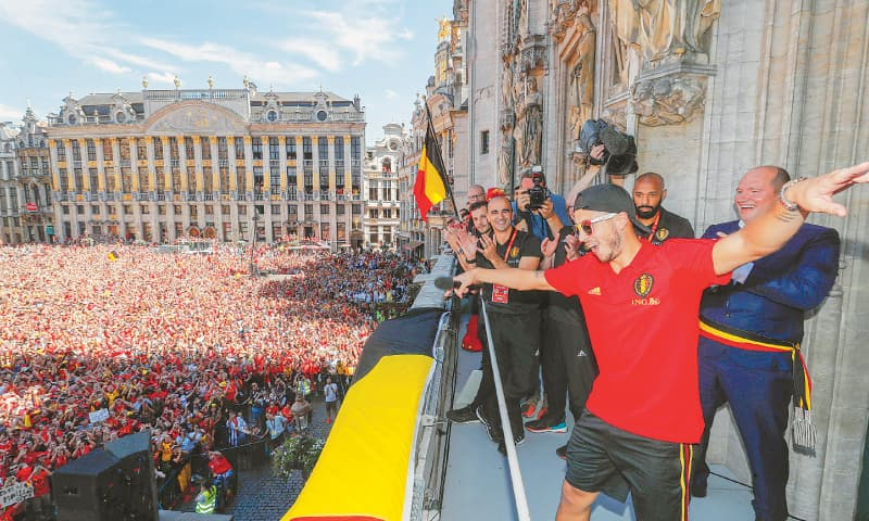 Belgium's Eden Hazard and team-mates celebrate winning the bronze medal at the Russia 2018 World Cup, in Brussels city centre. — AFP