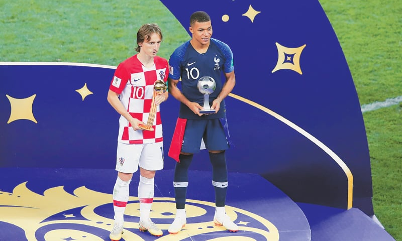 Croatia's Luka Modric (left) wins the Golden Ball, Kylian Mbappe of France gets the Young Player Award