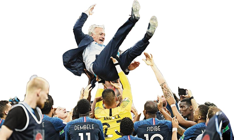 France's coach Didier Deschamps is tossed by players to celebrate their victory against Croatia in the final
