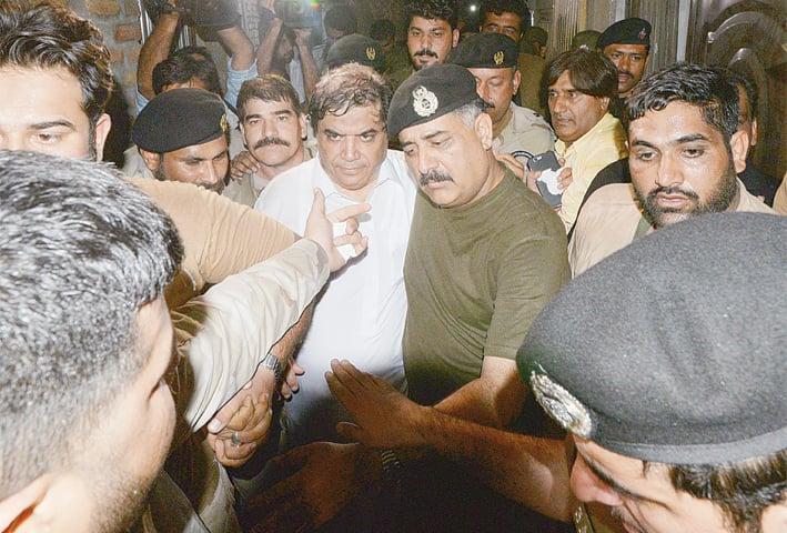 HANIF Abbasi being taken into custody on Saturday night.—Tanveer Shahzad / White Star