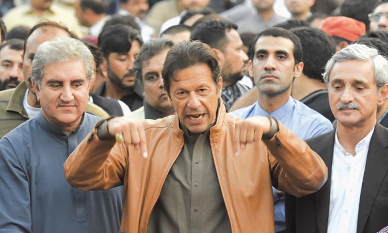 Shah Mehmood Qureshi and Jahangir Tareen flank Imran Khan in Bani Gala, Islamabad, on October 28, 2016. | Tanveer Shahzad/White Star