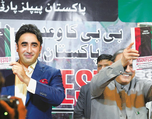 Bilawal Bhutto Zardari and his father hold copies of the PPP's manifesto | Tanveer Shahzad/White Star