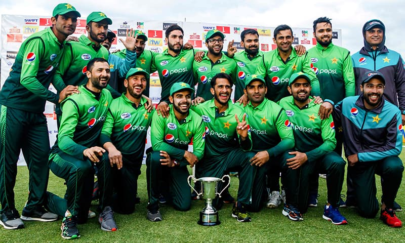 Pakistani players pose with the trophy during the prize ceremony after winning the fifth ODI series final match against Zimbabwe at the Queens Sports Club in Bulawayo, on Sunday. — AFP