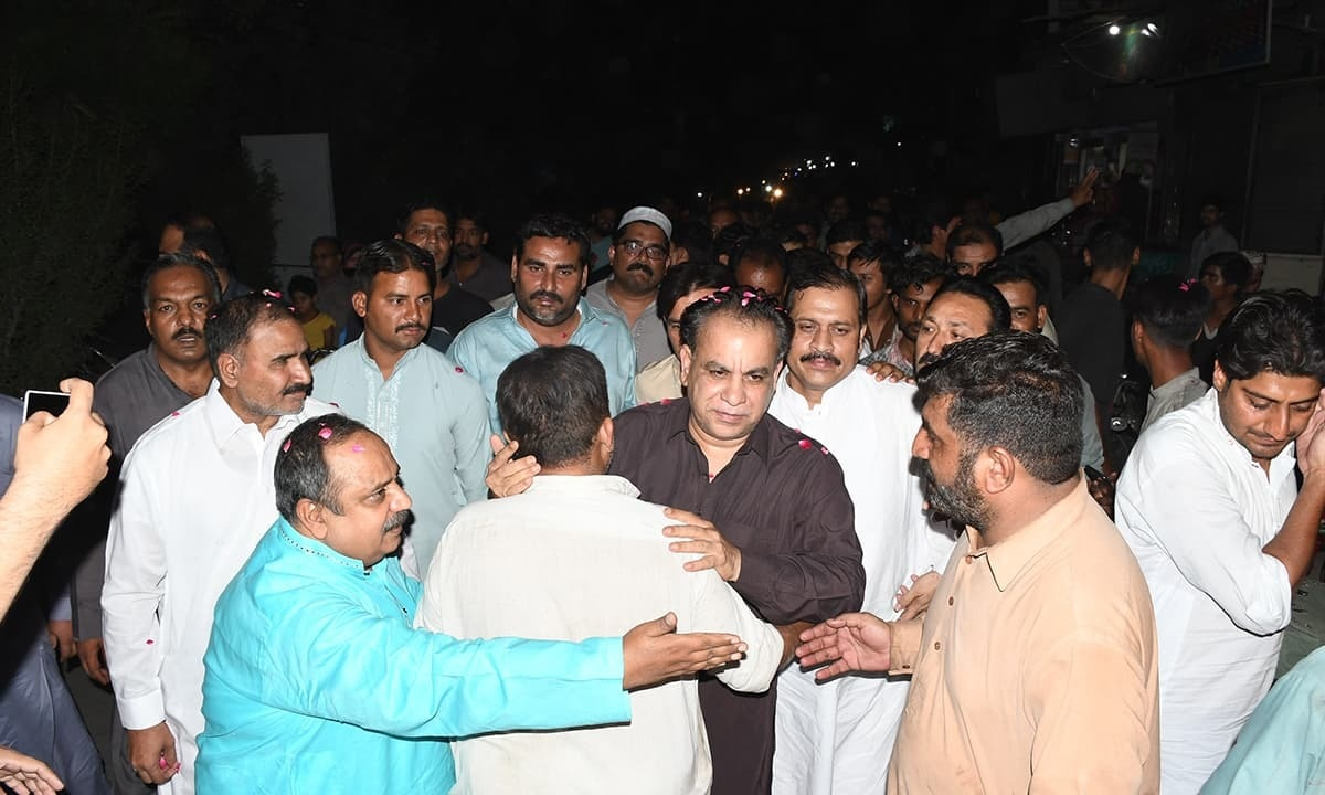 PTI candidate for NA-107 in Faisalabad, Sheikh Khurrum Shahzad, being welcomed by his supporters | Rizwan Safdar
