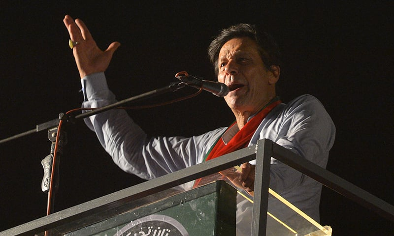 Pakistani cricketer turned politician Imran Khan of the Pakistan Tehreek-e-Insaf (Movement for Justice), speaks to supporters during a campaign rally ahead of the general election in Karachi on July 22, 2018. —AFP