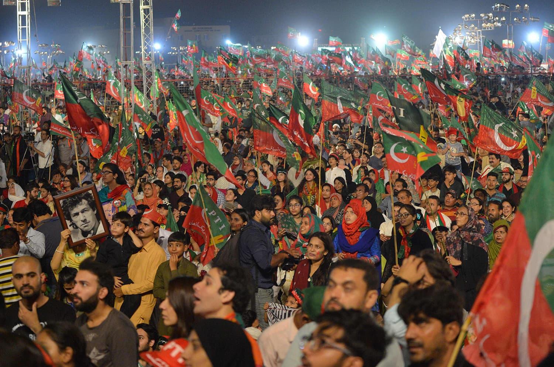 Supporters listen to Khan's address. —AFP