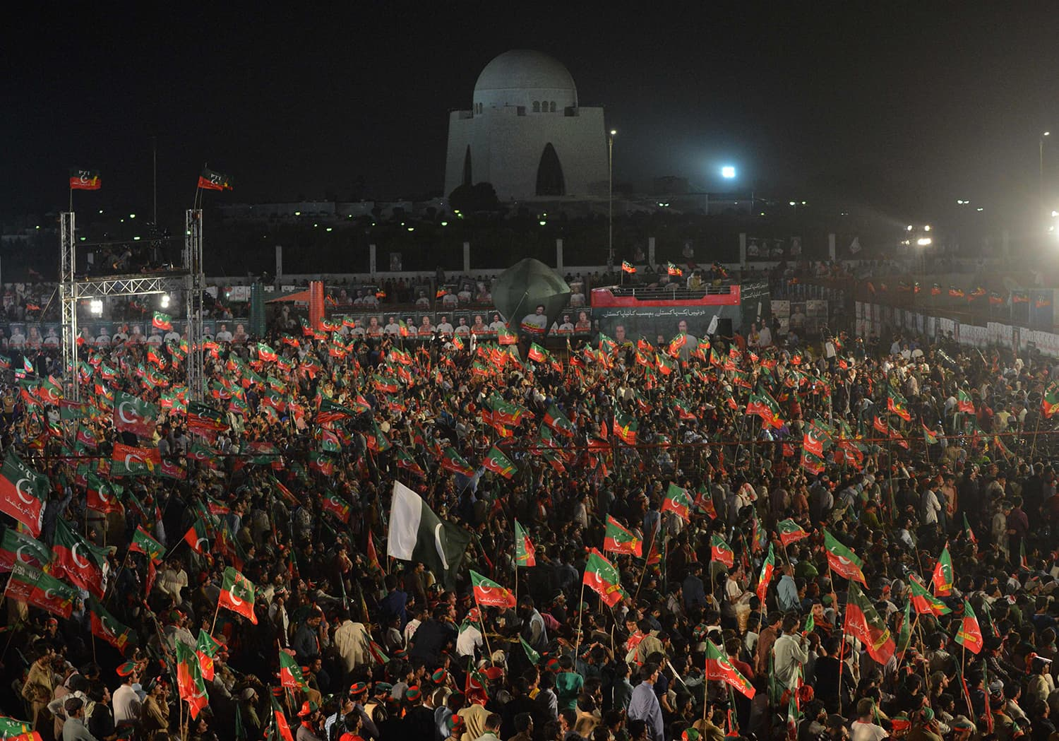 Supporters of Imran Khan attend an election campaign rally by PTI ahead of the general election in Karachi. —AFP