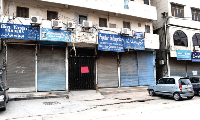 Chemist shops in Rawalpindi's Bohr Bazaar remain closed in protest against Hanif Abbasi's life sentence. — White Star