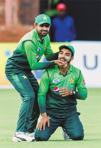 MAN-of-the-match Babar Azam helps out Shadab Khan who hurt his neck.—AFP
