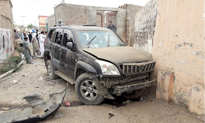 DERA ISMAIL KHAN: The damaged vehicle of Ikramullah Gandapur in which he was travelling at the time of the suicide attack on Sunday.—AFP