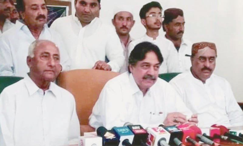 IN this file photo, PML-F Sindh president Sadruddin Shah Rashidi addresses a press conference with the GDA-supported NA-218 candidate Syed Ali Nawaz Shah (left) in Mirpurkhas a few days before the elections.
