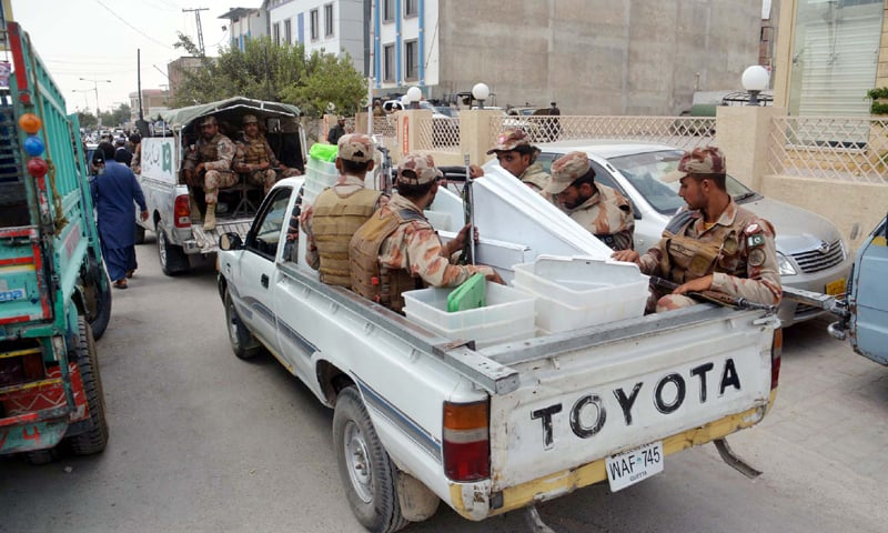 QUETTA: Polling material is being taken to polling stations under the supervision of security personnel on Tuesday.—PPI