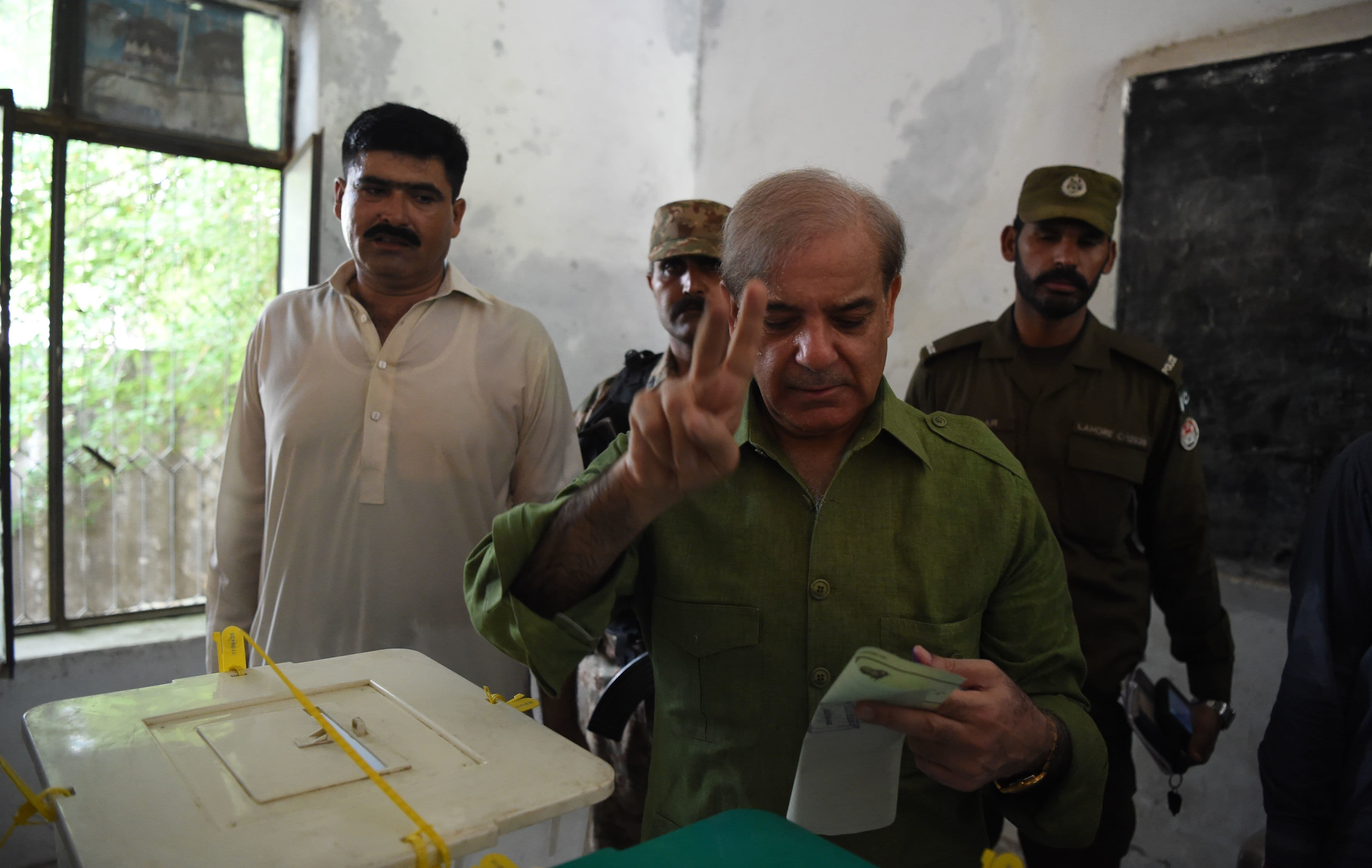 Shahbaz Sharif casts his vote in Lahore. — AFP