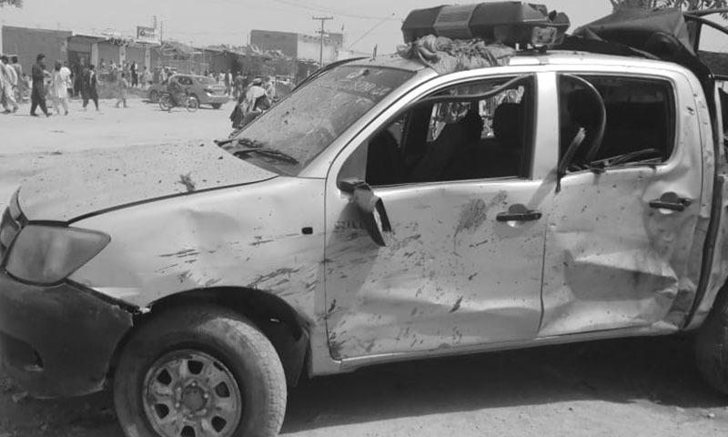 A view of a police van that was damaged in the blast. — DawnNewsTV