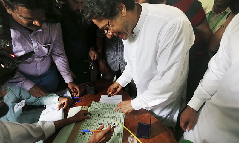 PTI Chairman Imran Khan casts his vote at a polling station in Islamabad on July 25. ─ File