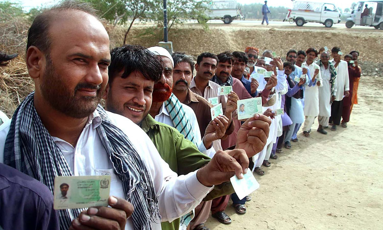 Voters standing in queue to cast their ballots outside polling station in Hyderabad. — APP