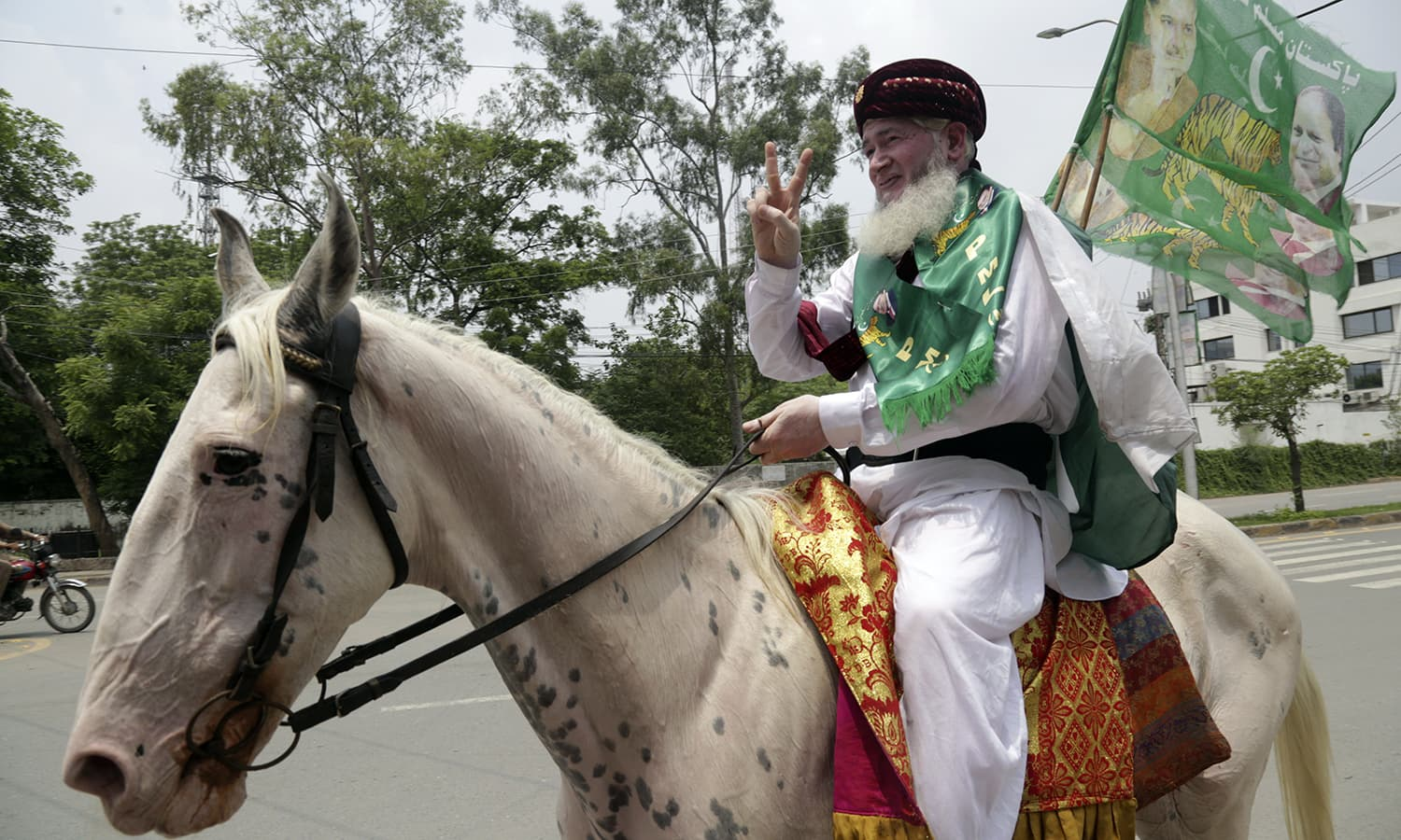 A supporter of former prime minister Nawaz Sharif arrives at a polling station to cast his vote in Lahore. — AP