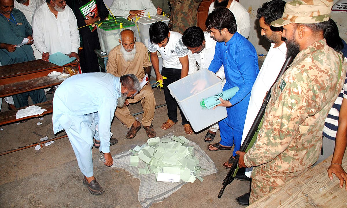 Polling officials start counting votes in Multan. ─ APP