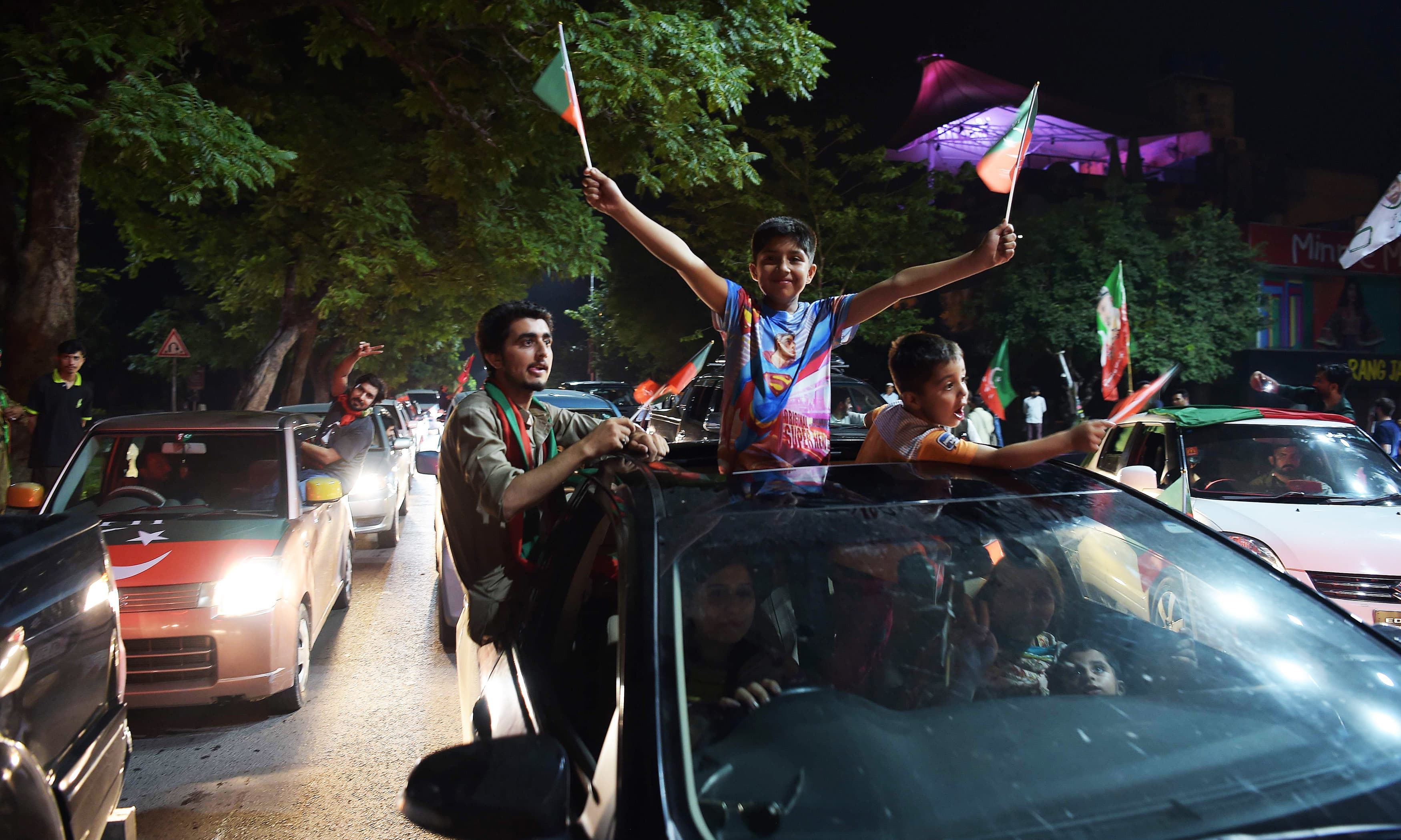 Imran Khan's supporter celebrate on a street in Islamabad. —AFP