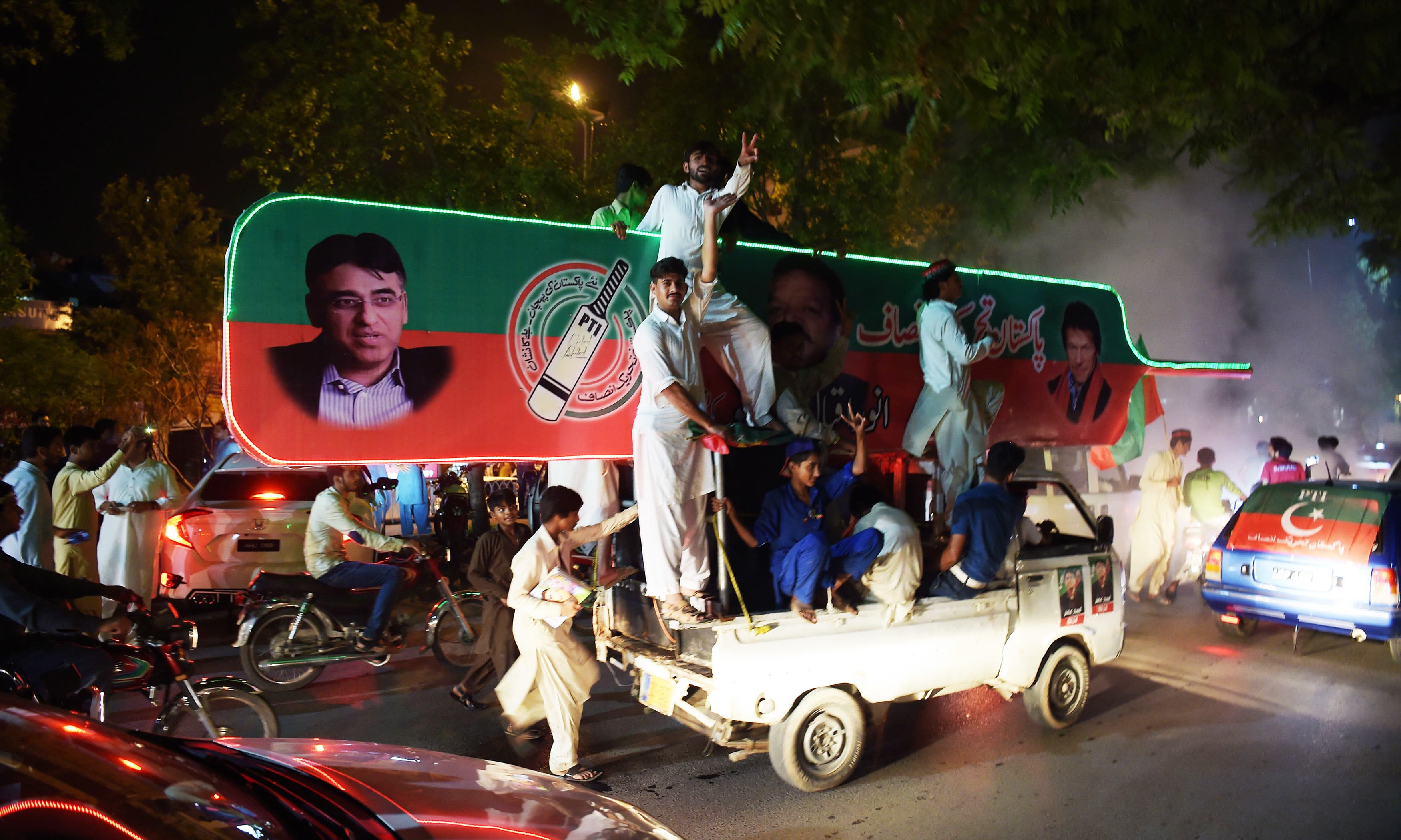 PTI supporters celebrate in Islamabad. —AFP