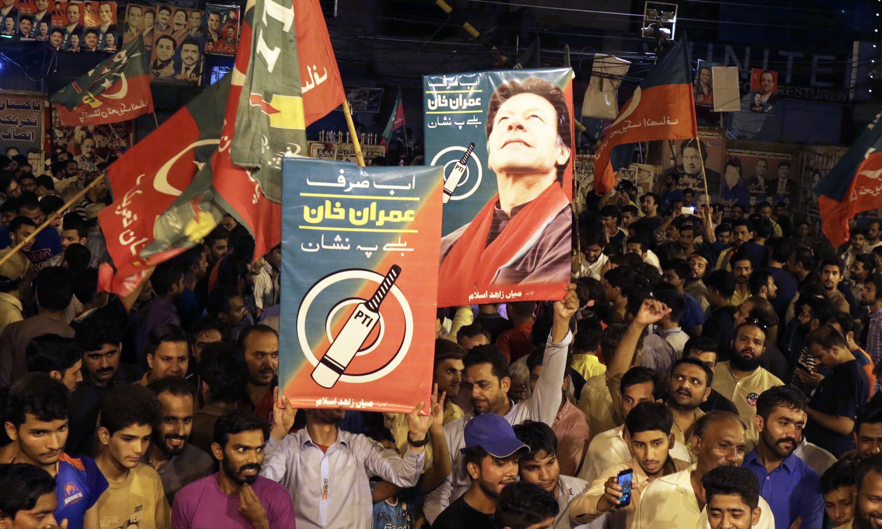 PTI supporters celebrate following the announcement of projected unofficial results indicating their candidates' success in the elections in Islamabad. —AP
