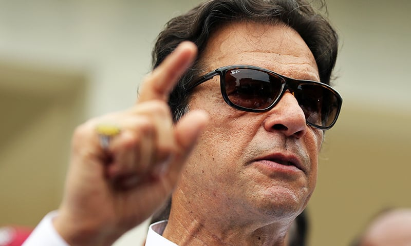 Imran Khan, chairman of Pakistan Tehreek-e-Insaf (PTI), speaks to members of media after casting his vote at a polling station during the general election in Islamabad, Pakistan, July 25, 2018. Photo: Reuters
