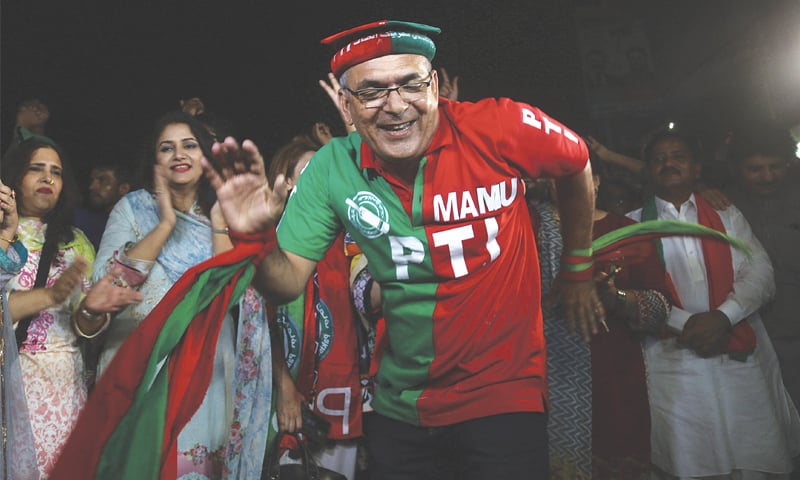 PTI supporters celebrate their election victory at Insaf House, the party headquarters in the city, on Thursday.—White Star