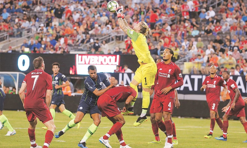 EAST RUTHERFORD (New Jersey): Liverpool goalkeeper Loris Karius punches the ball away against Manchester City at the MetLife Stadium.—Reuters