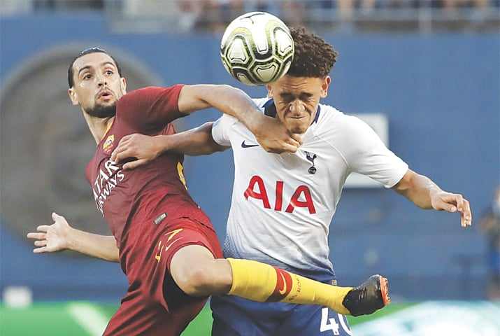 SAN DIEGO (California): Tottenham's Luke Amos (R) competes for the ball with Javier Pastore of AS Roma.—AP
