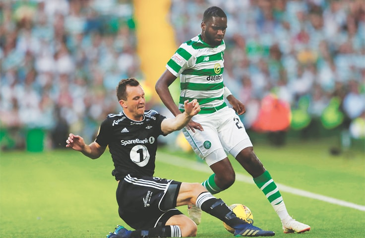 GLASGOW: Rosenborg's Even Hovland (L) challenges Celtic's Odsonne Edouard at Celtic Park.—Reuters