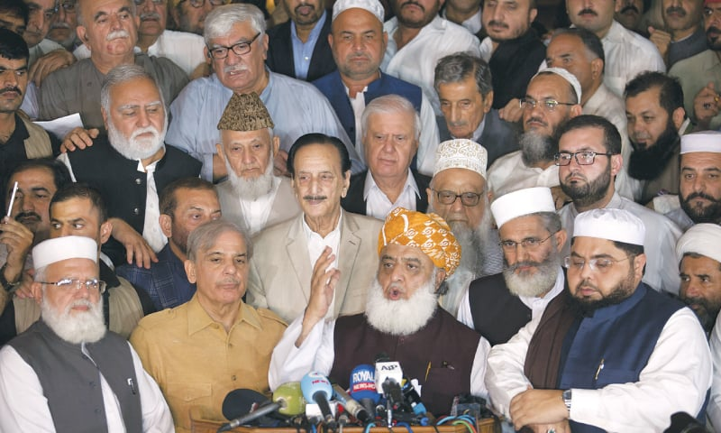 ISLAMABAD: Maulana Fazalur Rehman speaks to media at the multi-party conference called by him on Friday. Sirajul Haq, Shahbaz Sharif, Raja Zafarul Haq, Asfandyar Wali, Aftab Ahmed Khan Sherpao and others are present.—White Star