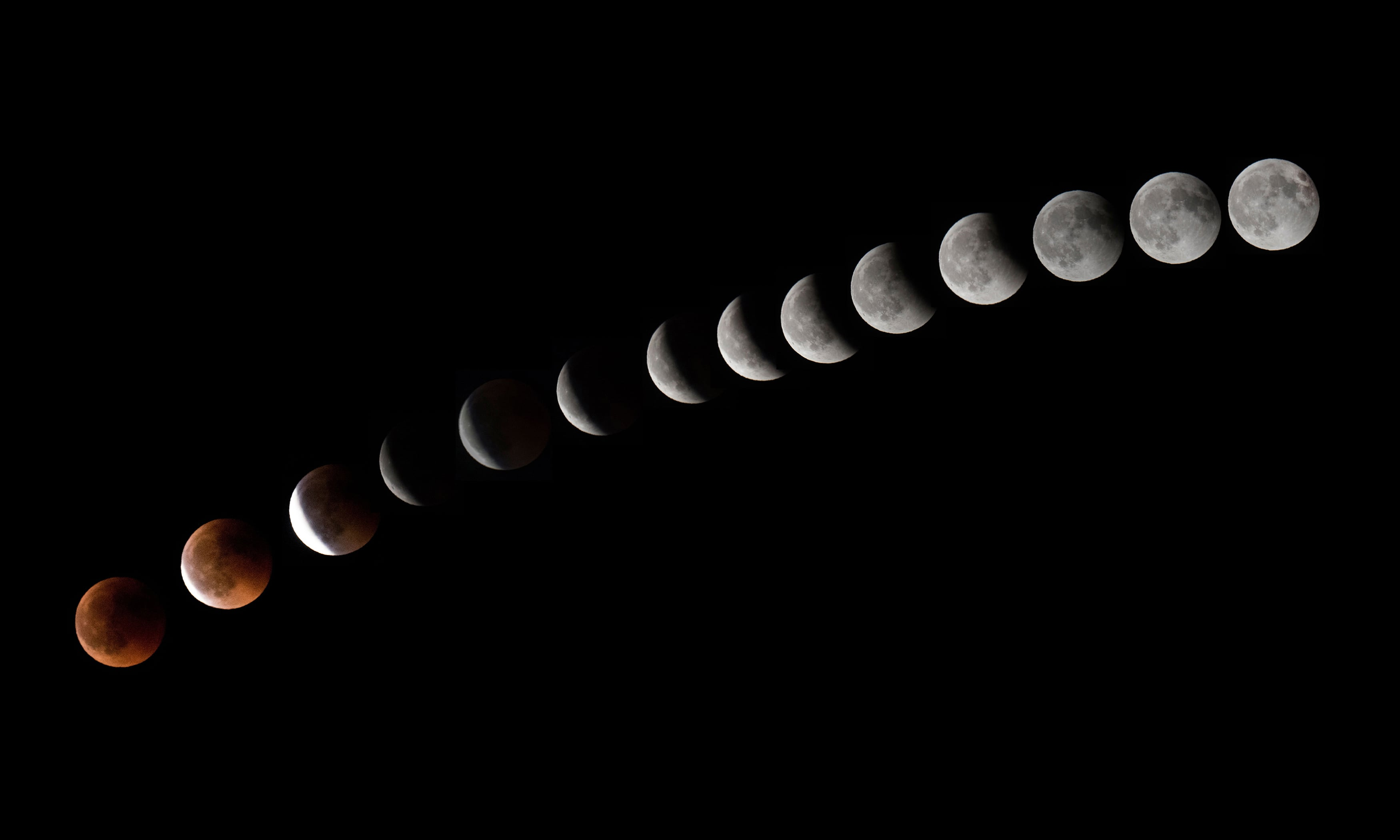 This combination of 14 pictures put together in photoshop and taken on July 27,2018 shows the moon during a total lunar eclipse near to La Puente town, canary Spanish island of Tenerife. — AFP