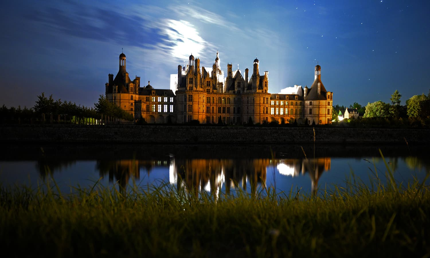 """A """"blood moon"""" eclipse is seen over the roof of the Chambord Castle in Chambord, France. — AFP"""