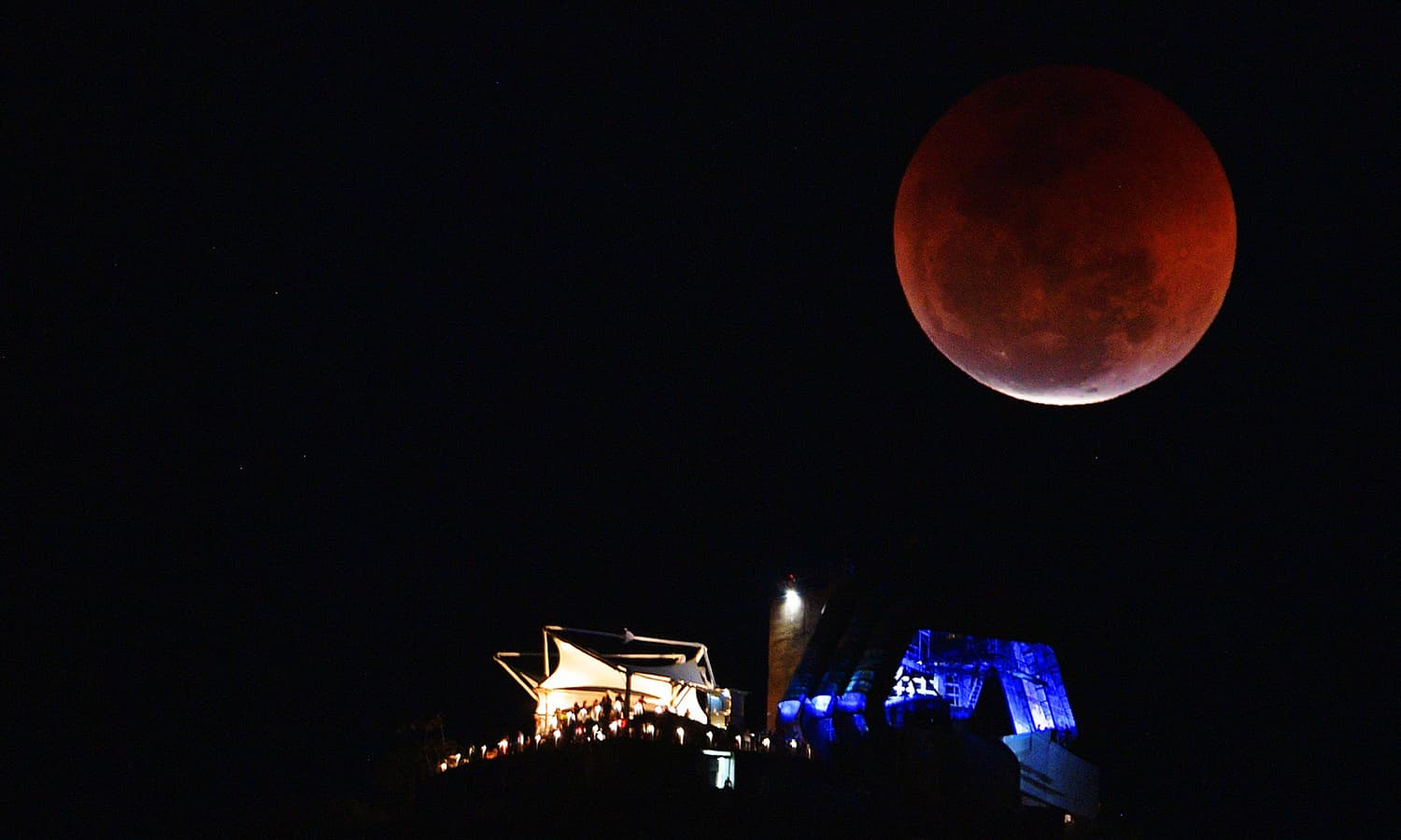 View of a moon eclipse over the Sugar Loaf mountain in Rio de Janeiro, Brazil on July 27, 2018. — AFP