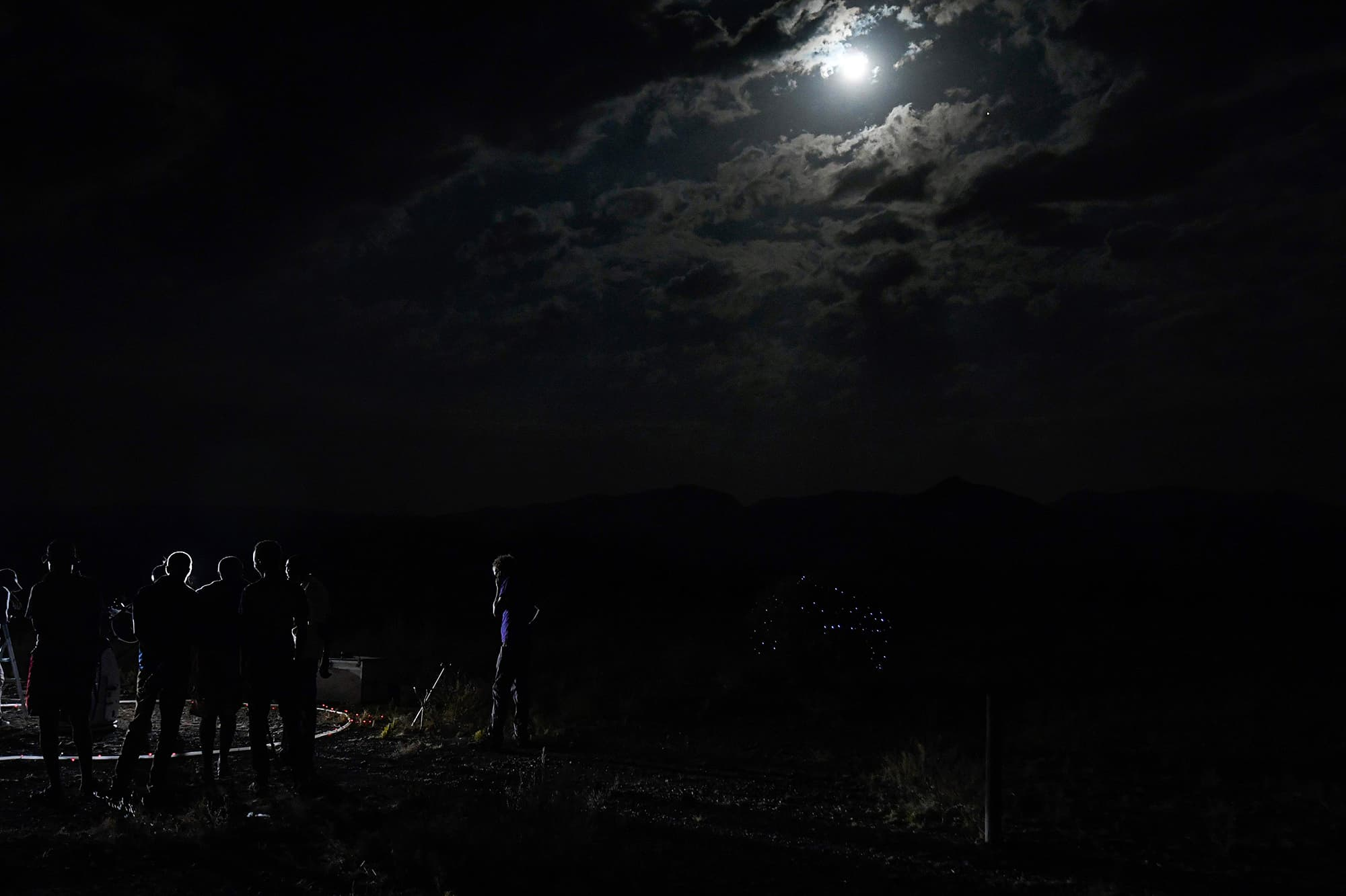 """People look at a """"blood moon"""" eclipse in Oloika town in Magadi, Kenya. — AFP"""