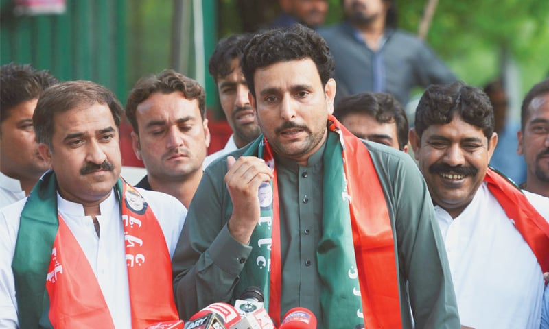 NEWLY-elected independent candidates Rafaqat Ali Gillani (centre), Muhammad Hanif Pitafi (left) and Muhammad Basharat Randhawa, who joined PTI, talk to the media after a meeting with party chairman Imran Khan on Saturday. Mr Randhawa and Mr Gillani had contested the election after they were denied the PTI tickets.—AFP