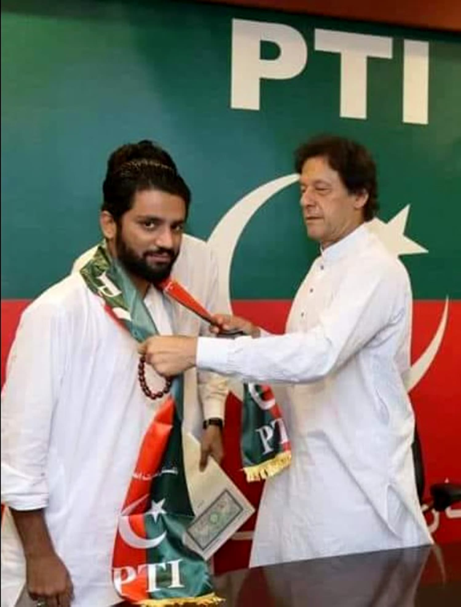 Muhammad Salman being welcomed into the party by PTI chief Imran Khan. —Photo by the author